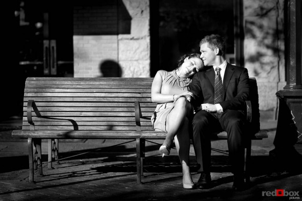 The bride and groom, Tom & Michele, sit on a bench in Pioneer Square prior to their wedding at the King County Courthouse in Seattle. They held their reception at the Novelty Hll-Januik Winery in Woodinville, Wash. Seattle Wedding photography by Scott Eklund/Red Box Pictures
