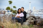 Nick and Tia sit at Seacrest Park in West Seattle for their engagement portrait session. (Photography by Andy Rogers/Red Box Pictures)