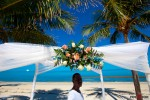 The florist works on the flowers for the arch at the Old Bay Bahama Resort in the Bahamas. (Wedding Photography by Scott Eklund/Red Box Pictures)