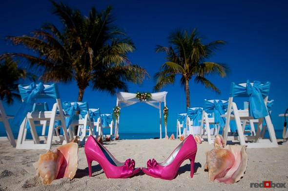The brides shoes with some conch shells at the Old Bay Bahama Resort in the Bahamas. (Wedding Photography by Scott Eklund/Red Box Pictures)