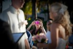 A friend snaps a picture during the wedding of Tasha & Jeff at their wedding at the Old Bay Bahama Resort in the Bahamas. (Wedding Photography by Scott Eklund/Red Box Pictures)