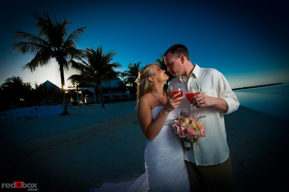The bride & groom drink Bahama Mamas at the Old Bay Bahama Resort in the Bahamas. (Wedding Photography by Scott Eklund/Red Box Pictures)