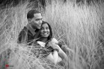 Nick and Tia talk in the tall grass at Seacrest Park in West Seattle for their engagement portrait photos. (Photography by Andy Rogers/Red Box Pictures)