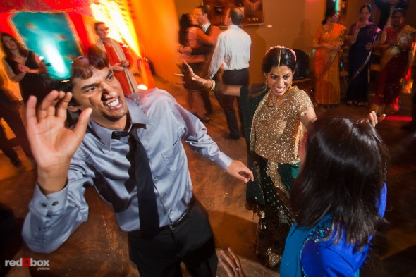 Karthik dances with family members after her Hindu and Jewish wedding ceremonyies at the Uptown Hideaway in Seattle. (Photography by Andy Rogers/Red Box Pictures)