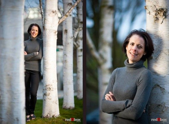 Liz poses among alder trees during a portrait photography session along Seattle's waterfront. (Photo by Dan DeLong/Red Box Pictures)