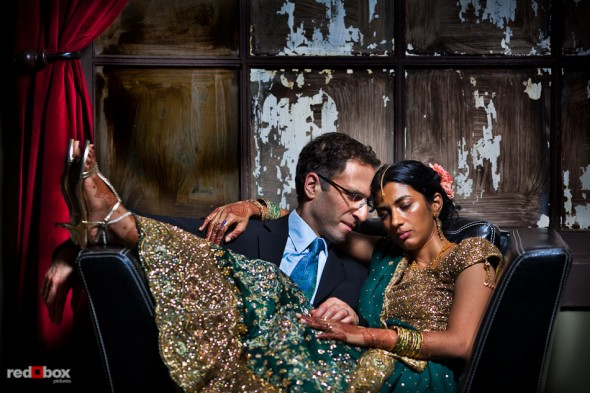 Karthik and Mike relax in a back room at the Uptown Hideaway following their Hindu and Jewish wedding ceremonies in Seattle. (Photo by Andy Rogers/Red Box Pictures)