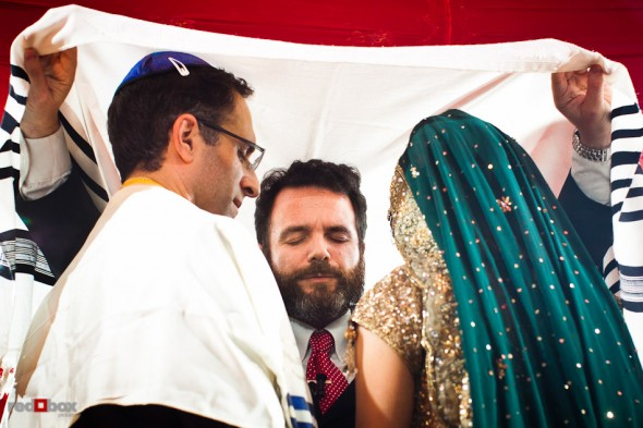 Rabbi Olivier Benhaim performs Karthik and Mike's Jewish wedding ceremony at the Uptown Hideaway in Seattle. (Photo by Dan DeLong/Red Box Pictures)