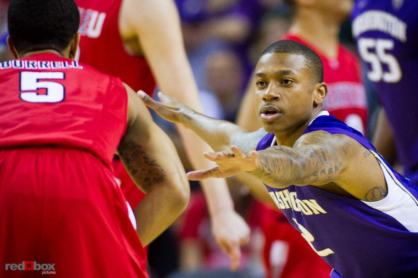 The University of Washington Huskies&#039; guard Isaiah Thomas defends against the Seattle University Redhawks at Key Arena in Seattle Tuesday, Feb. 22, 2011. (Photo by Andy Rogers/Red Box Pictures)