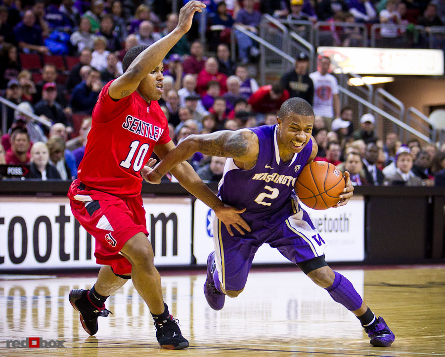 The University of Washington Huskies guard Isaiah Thomas drives to the basket against Sterling Carter of the Seattle University Redhawks at Key Arena in Seattle Tuesday, Feb. 22, 2011. (Photo by Andy Rogers/Red Box Pictures)