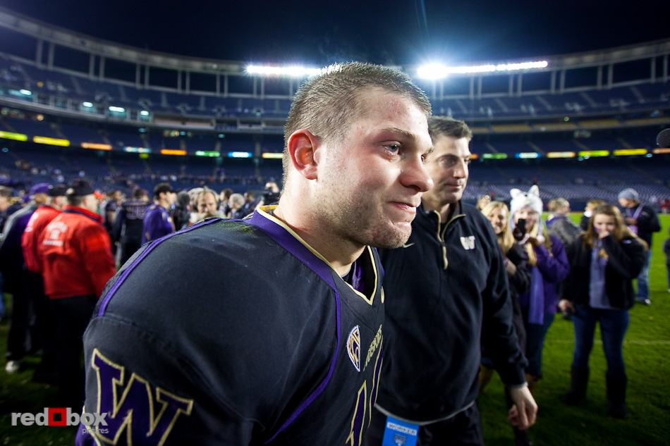 Jake Locker has a tear in his eye after being congratulated by Doug Nussmeier following the University of Washington's defeat of Nebraska in the 2010 Bridgepoint Education Holiday Bowl 19-7 at Qualcomm Stadium in San Diego. (Photography By Scott Eklund/Red Box Pictures)