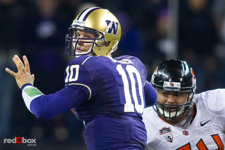 University of Washington quarterback Jake Locker prepares to pass against Oregon State University. UW defeated OSU 35-34 in double overtime at Husky Stadium in Seattle on Saturday October 16, 2010. (Photography By Scott Eklund/Red Box Pictures)