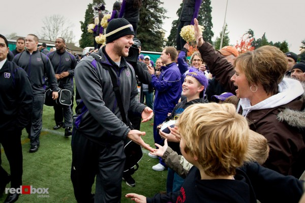 Jake Locker greets fans as he arrives for a game against UCLA at Husky Stadium on Thursday November 18, 2010. (Photography By Scott Eklund/Red Box Pictures)