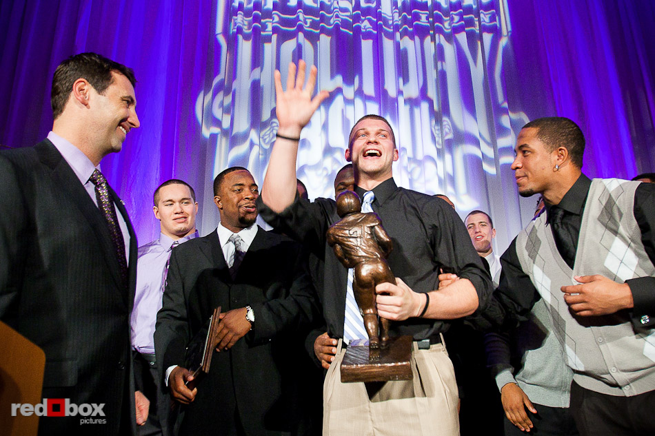 Jake Locker accepts the Guy Flaherty Most Inspirational Player award during the 2010 UW Huskies Football Banquet at the Westin hotel in Seattle Tuesday, Dec. 7, 2010. (Photo by Andy Rogers/Red Box Pictures)