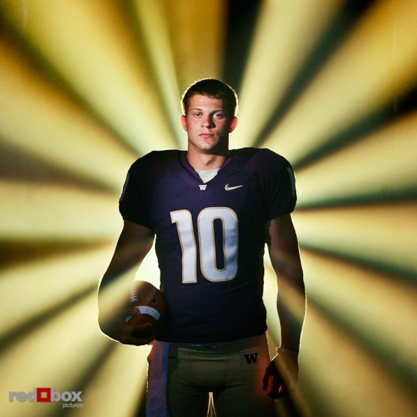 Jake Locker stands for a portrait photo in the tunnel to Husky Stadium as a freshman quarterback for the University of Washington on August 21, 2007. Photo by Dan DeLong