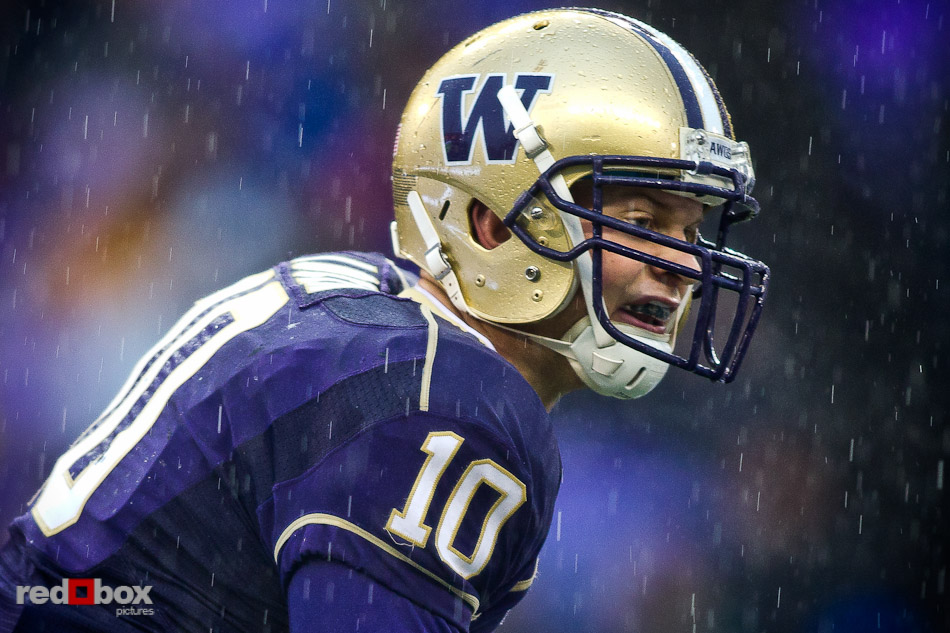Jake Locker endures a heavy downpour as The University of Washington takes on the Stanford Cardinal at Husky Stadium in Seattle Saturday, Oct. 30, 2010. (Photography by Andy Rogers/Red Box Pictures)