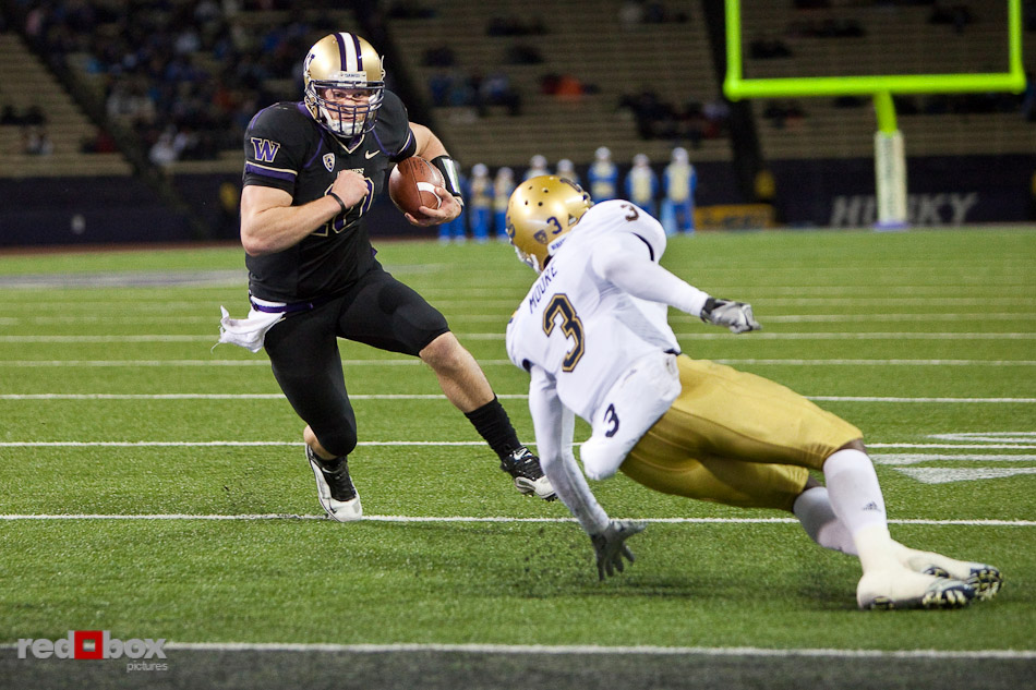 Jake Locker runs past UCLA defender for a touchdown as the University of Washington beat UCLA 24-7 at Husky Stadium on Thursday November 18, 2010. (Photography By Scott Eklund/Red Box Pictures)