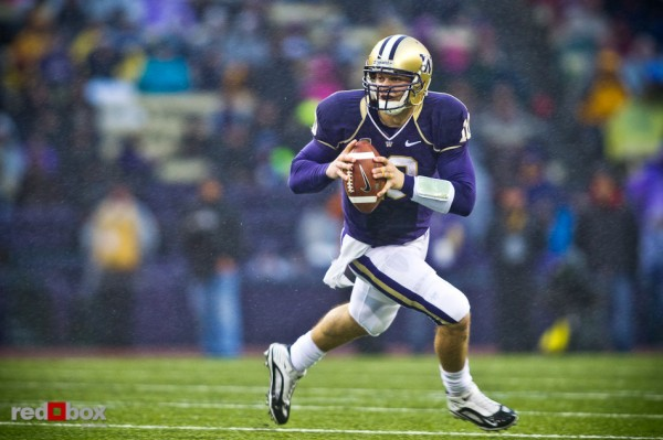 Jake Locker scrambles outside of the pocket in a downpour as the University of Washington takes on the Stanford Cardinal at Husky Stadium in Seattle Saturday, Oct. 30, 2010. (Photography by Andy Rogers/Red Box Pictures)