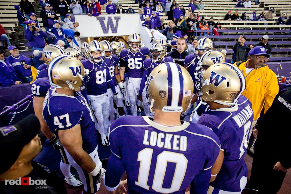 Jake Locker and his teammates huddle outside the tunnel prior to University of Washington's defeat of Oregon State University 35-34 in double overtime at Husky Stadium in Seattle on Saturday October 16, 2010. (Photography By Scott Eklund/Red Box Pictures)